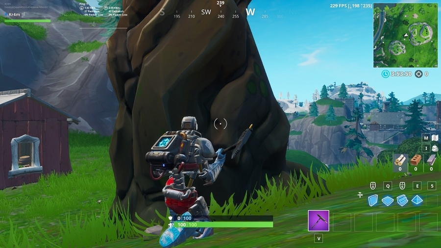 Fortnite bot hiding behind a tree