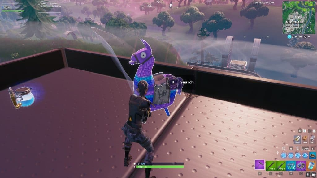 Breaking a llama in Fortnite by hitting it with a pickaxe