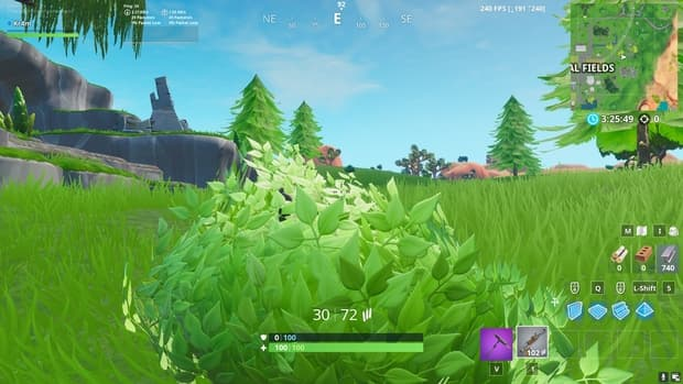 Hiding in a bush in Fortnite near Fatal Fields