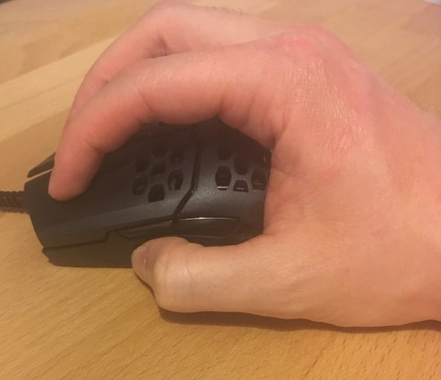 My hands gripping the MM710 with a claw grip